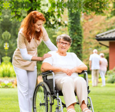 portrait of caregiver and senior woman on outside