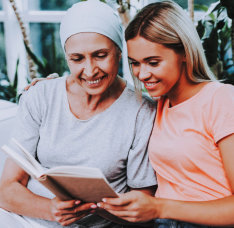 portrait of woman and senior woman reading