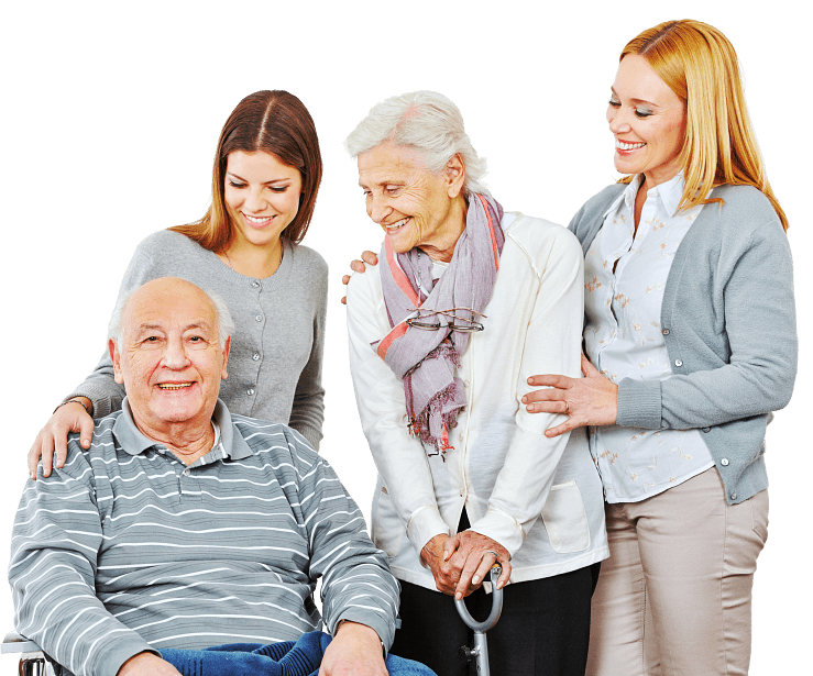 two caregivers and a senior couple smiling