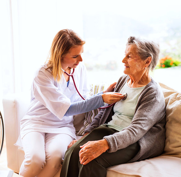 portrait of senior woman and caregiver talking