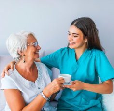 portrait of senior woman and caregiver smiling