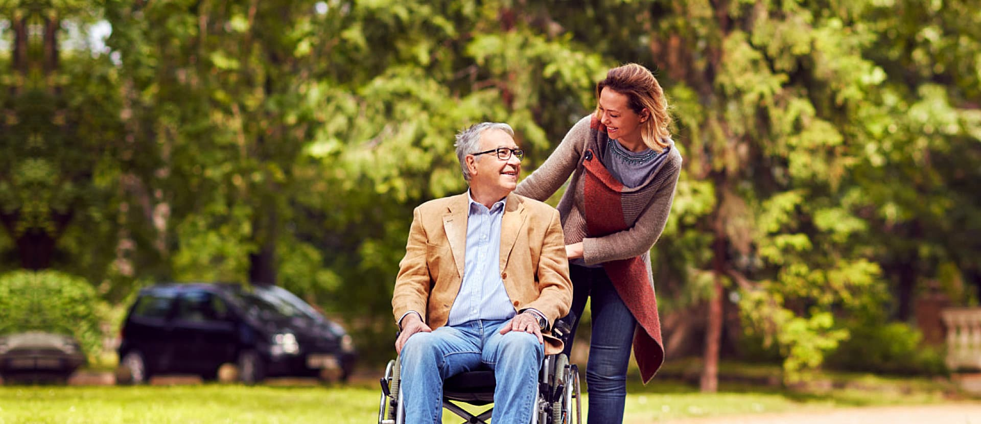 portrait of senior man and caregiver on outside