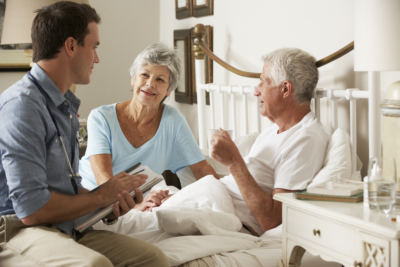doctor visiting a senior couple at home