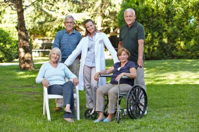 two senior couples with their nurse