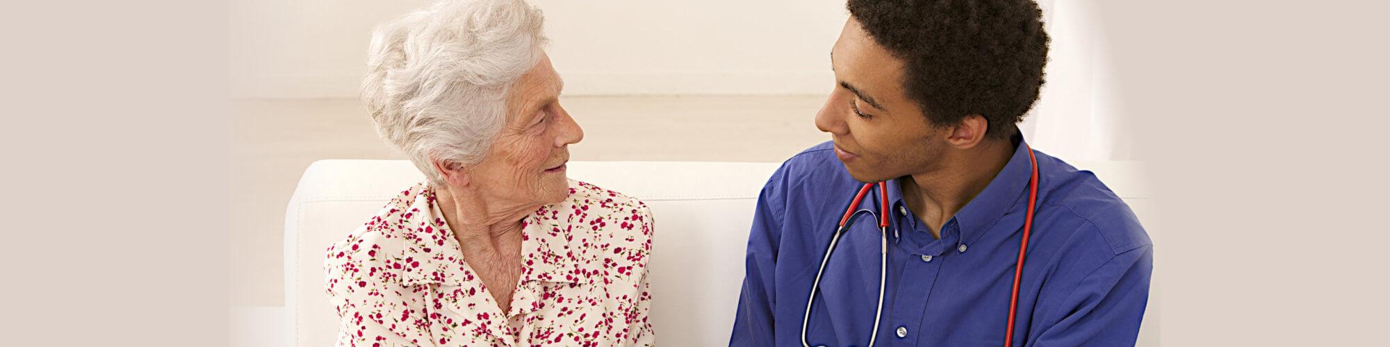 caregiver taking care her elderly