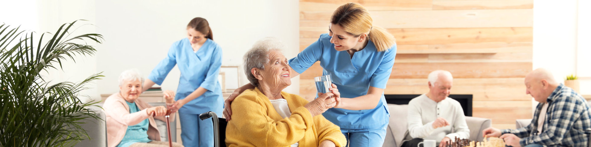 caregiver taking care her elderly